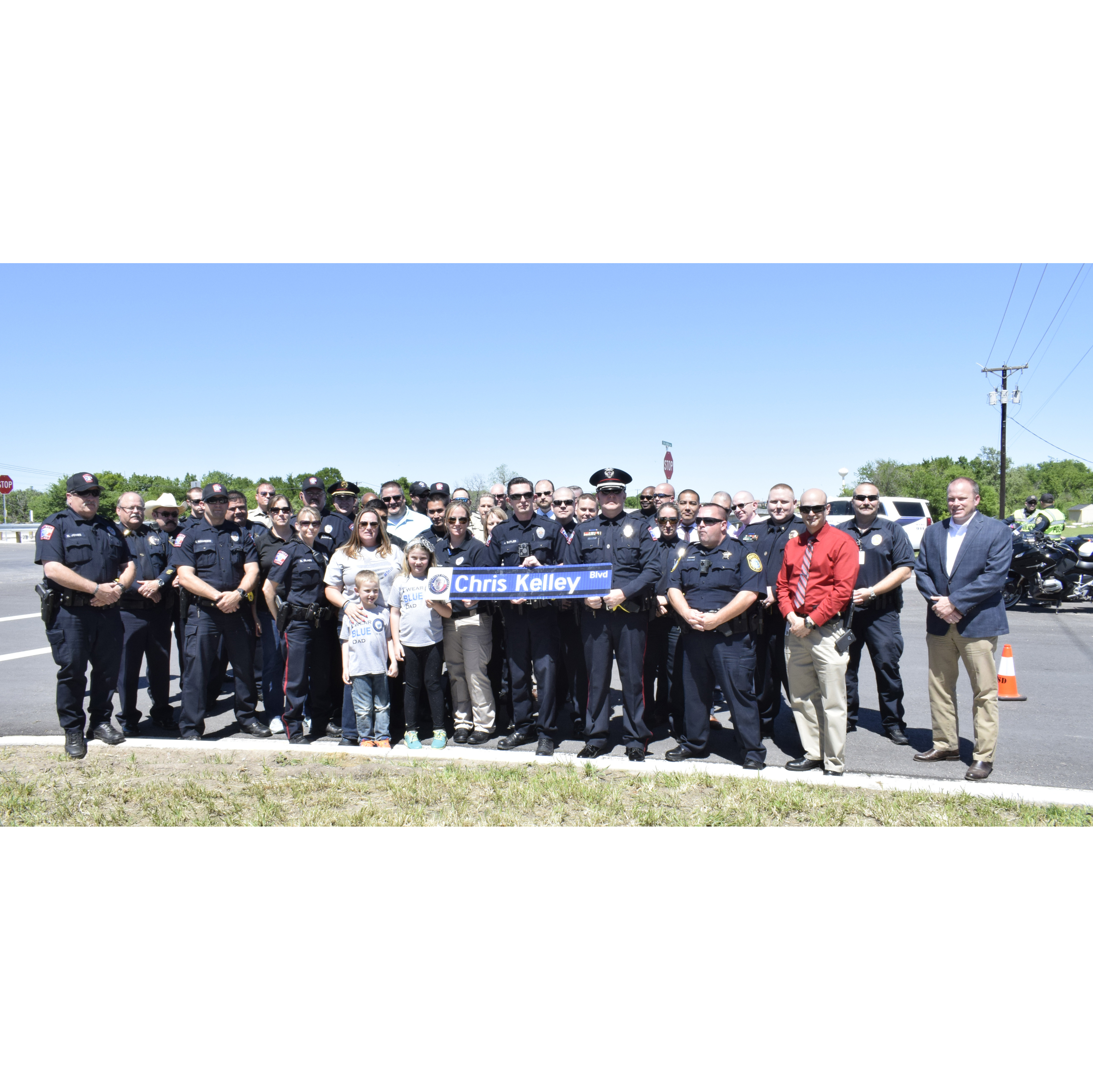 The Hutto Police Department and Chris Kelley's family attended the ribbon cutting ceremony and dedication. copy